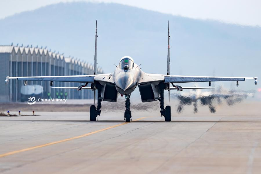 J-11B fighter jets attached to an aviation brigade of the air force with the PLA Northern Theater Command taxi on the flightline during a round-the-clock flight training exercise on January 3, 2019.  (Photo/eng.chinamil.com.cn)