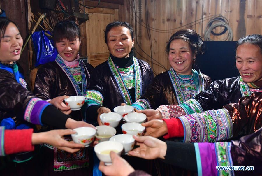 Villagers drink wine to wish for good luck during a get-together in Rongshui, Liuzhou City of south China\'s Guangxi Zhuang Autonomous Region, Jan. 5, 2019. Local Miao people celebrated their traditional New Year in various ways. (Xinhua/Huang Xiaobang)