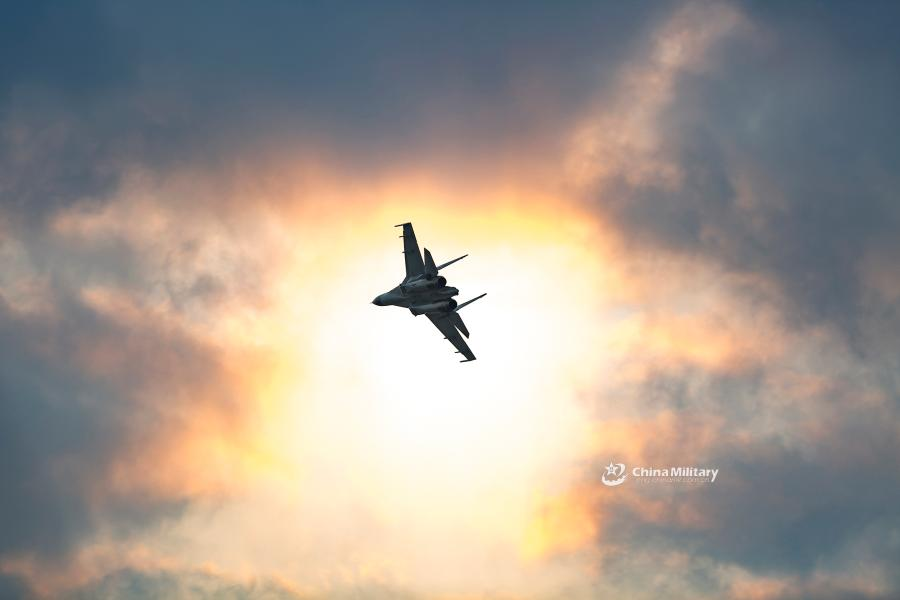 A J-11B fighter jet attached to an aviation brigade of the air force with the PLA Northern Theater Command flies past the sun during a round-the-clock flight training exercise on January 3, 2019. (Photo/eng.chinamil.com.cn)