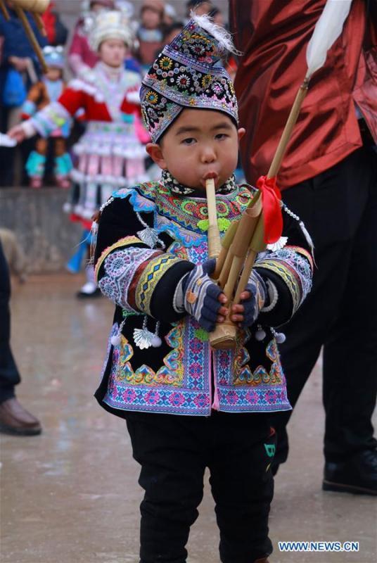 A boy of Miao ethnic group plays Lusheng in Rongshui, Liuzhou City of south China\'s Guangxi Zhuang Autonomous Region, Jan. 5, 2019. Local Miao people celebrated their traditional New Year in various ways. (Xinhua/Long Linzhi)