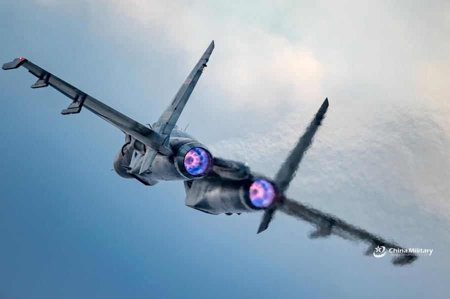 A J-11B fighter jet attached to an aviation brigade of the air force with the PLA Northern Theater Command flies in the sky during a round-the-clock flight training exercise on January 3, 2019.  (Photo/eng.chinamil.com.cn)