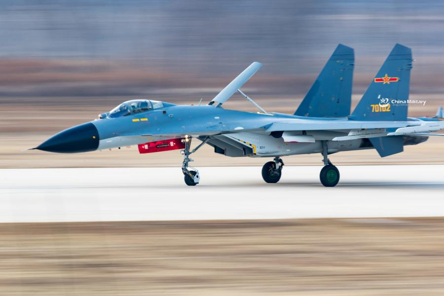 A J-11B fighter jet attached to an aviation brigade of the air force with the PLA Northern Theater Command taxis on the runway after landing during a round-the-clock flight training exercise on January 3, 2019. (Photo/eng.chinamil.com.cn)