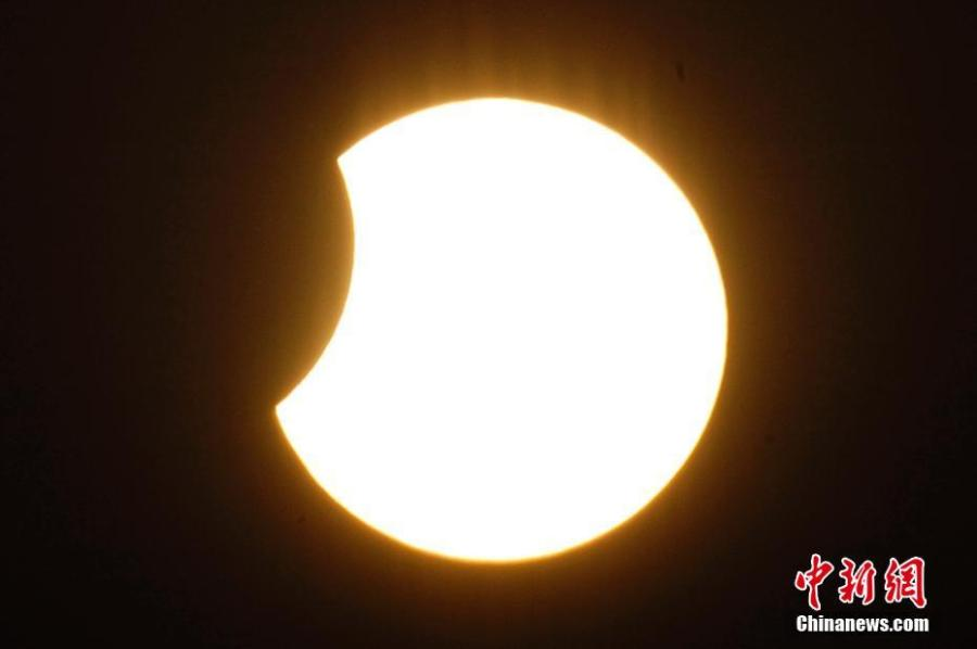 A partial solar eclipse is observed in Tianjin, Jan. 6, 2019. (Photo: China News Service/Tong Yu)