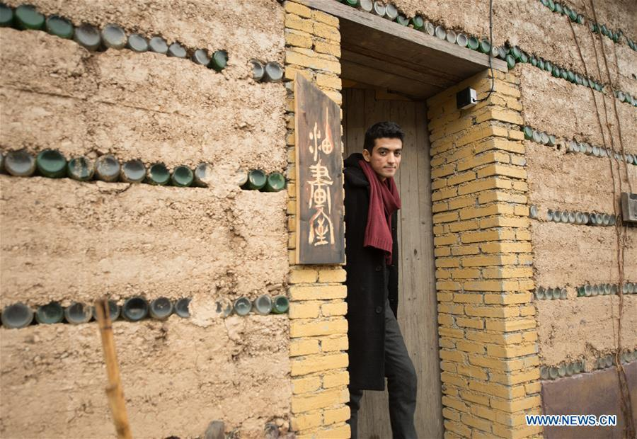 Mehraz Karami walks out of his workshop at Shanbei Village in Daixi Town of Huzhou City, east China\'s Zhejiang Province, Jan. 7, 2019. Iranian Mehraz Karami, who was born in Tehran in 1993, has shown his interest in Chinese culture ever since his childhood. He came to Daixi Town and set up his own painting workshop at the end of 2017 after graduation from east China\'s Shanghai. He said he hoped to stay in China and become an artist. (Xinhua/Weng Xinyang)