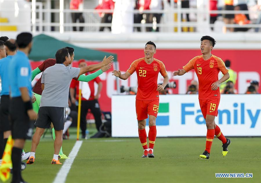 Yu Dabao (2nd R) of China celebrates scoring during the group C match between China and Kyrgyz Republic of the AFC Asian Cup UAE 2019 in Al Ain, the United Arab Emirates (UAE), on Jan. 7, 2019. China won 2-1. (Xinhua/Ding Xu)