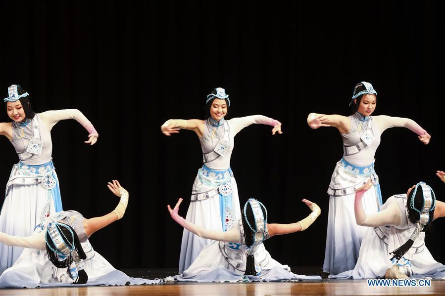 Students from the Great Wall Chinese School perform a Chinese folk dance during a New Year celebration organized by Greater Philadelphia Chinese School of Union (GPCSU) in Philadelphia, the United States, on Jan. 6, 2019. More than 100 young Chinese Americans have charmed fans of traditional Chinese folk dances and costumes in a grand New Year celebration performance. (Xinhua/Wang Ying)
