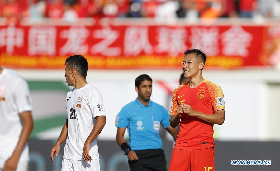 Wu Xi (1st R) of China reacts during the group C match between China and Kyrgyz Republic of the AFC Asian Cup UAE 2019 in Al Ain, the United Arab Emirates (UAE), on Jan. 7, 2019. China won 2-1. (Xinhua/Ding Xu)