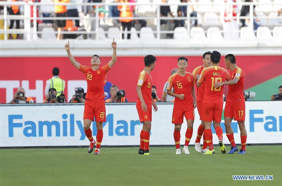 Yu Dabao (1st L) of China celebrates scoring during the group C match between China and Kyrgyz Republic of the AFC Asian Cup UAE 2019 in Al Ain, the United Arab Emirates (UAE), on Jan. 7, 2019. China won 2-1. (Xinhua/Ding Xu)