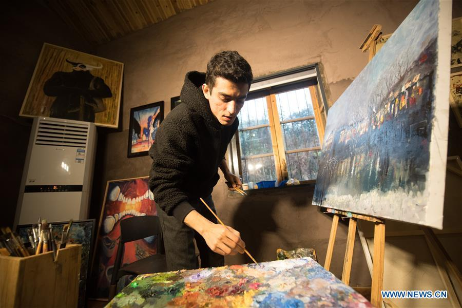 Mehraz Karami paints at his workshop in Shanbei Village of Daixi Town in Huzhou City, east China\'s Zhejiang Province, Jan. 7, 2019. Iranian Mehraz Karami, who was born in Tehran in 1993, has shown his interest in Chinese culture ever since his childhood. He came to Daixi Town and set up his own painting workshop at the end of 2017 after graduation from east China\'s Shanghai. He said he hoped to stay in China and become an artist. (Xinhua/Weng Xinyang)
