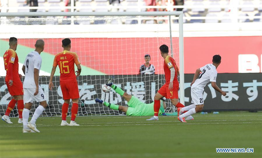 Akhlidin Israilov (1st R) of Kyrgyz Republic scores during the group C match between China and Kyrgyz Republic of the AFC Asian Cup UAE 2019 in Al Ain, the United Arab Emirates (UAE), on Jan. 7, 2019. China won 2-1. (Xinhua/Ding Xu)