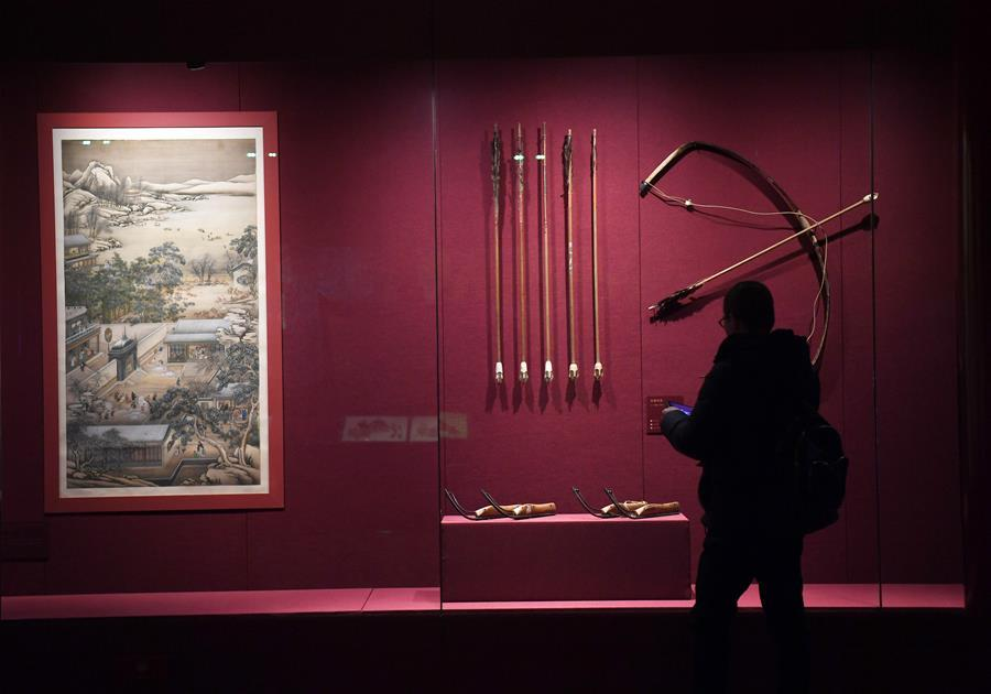 A tourist looks at exhibits displayed at the Palace Museum, also known as the Forbidden City in Beijing, capital of China, Jan. 7, 2019. In celebrating of the most magnificent of all traditional holidays, the Palace Museum presents exhibition of \