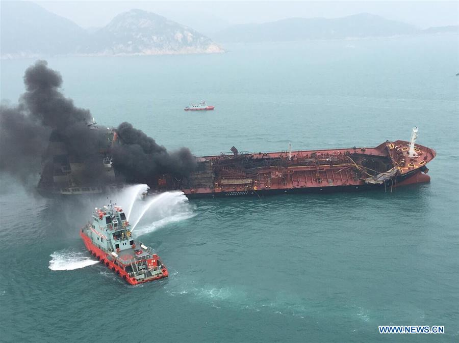 A rescue boat puts out fire that occurred on an oil tanker off Hong Kong\'s Lamma Island, Jan. 8, 2019. One person was killed, seven injured and two missing as an oil tanker exploded and caught fire Tuesday. The accident occurred at around 11:29 a.m. local time (0329 GMT) when crew members on the 140-meter-long oil tanker were trying to connect pipes with an oil barge to refuel the ship south off Lamma Island, said Yiu Men Yeung, division commander for marine and diving of Hong Kong Special Administrative Region (HKSAR) government\'s Fire Services Department (FSD). (Xinhua)