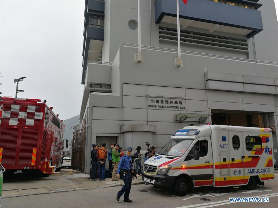 Rescuers and media workers are seen outside the Marine Police Aberdeen Base in Hong Kong, south China, Jan. 8, 2019. One person was killed, seven injured and two missing as an oil tanker exploded and caught fire Tuesday off Hong Kong\'s Lamma Island. The accident occurred at around 11:29 a.m. local time (0329 GMT) when crew members on the 140-meter-long oil tanker were trying to connect pipes with an oil barge to refuel the ship south off Lamma Island, said Yiu Men Yeung, division commander for marine and diving of Hong Kong Special Administrative Region (HKSAR) government\'s Fire Services Department (FSD). (Xinhua/Wu Xiaochu)
