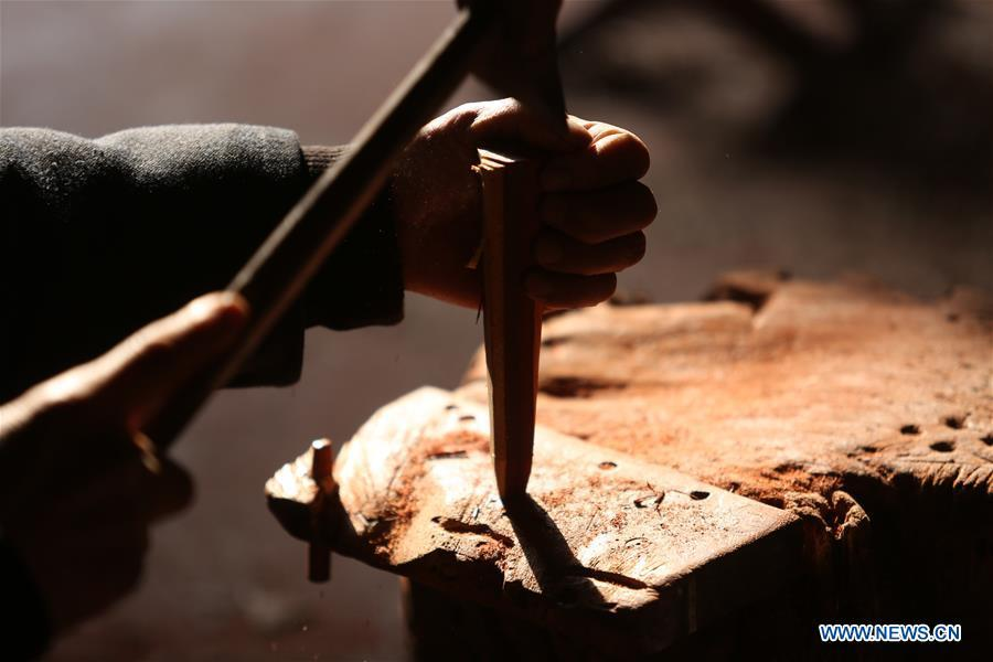 Villager Gao Zhenbao makes parts of Erhu, a Chinese two-stringed bowed instrument at Yuequan Village of Miaoshan Town in Linyi City, east China\'s Shandong Province, Jan. 8, 2019. Yuequan is famous for its time-honored handmade Erhu, with more than 90 households dedicated to it in the village. (Xinhua/Zhang Chunlei)