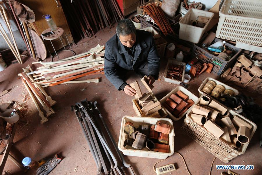 Villager Gao Zhenbao checks parts of Erhu, a Chinese two-stringed bowed instrument at Yuequan Village of Miaoshan Town in Linyi City, east China\'s Shandong Province, Jan. 8, 2019. Yuequan is famous for its time-honored handmade Erhu, with more than 90 households dedicated to it in the village. (Xinhua/Zhang Chunlei)