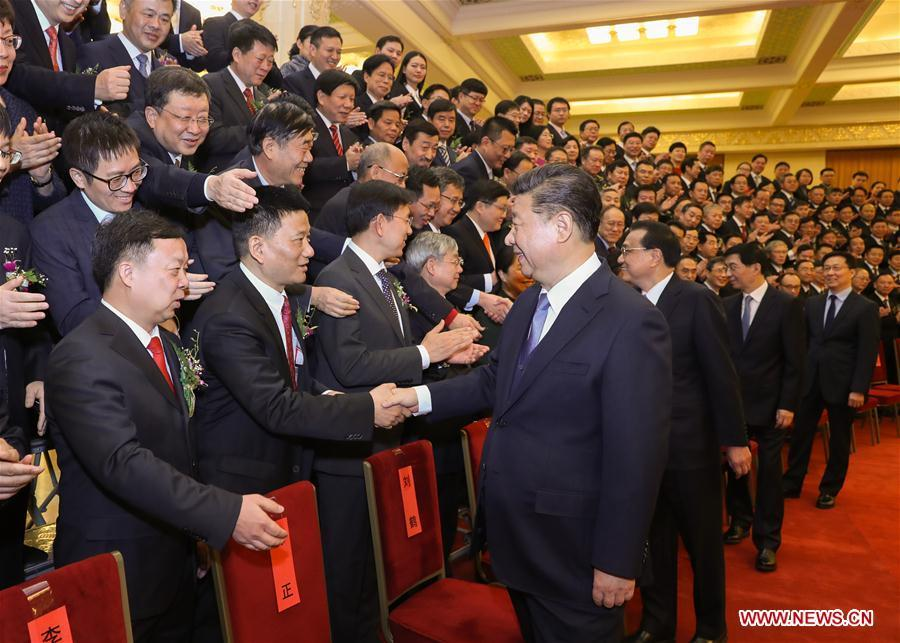 Chinese President Xi Jinping, also general secretary of the Communist Party of China (CPC) Central Committee and chairman of the Central Military Commission, and other leaders, including Li Keqiang, Wang Huning, and Han Zheng, all members of the Standing Committee of the Political Bureau of the CPC Central Committee, meet with representatives of the winners before an annual ceremony to honor distinguished scientists, engineers, and research achievements at the Great Hall of the People in Beijing, capital of China, Jan. 8, 2019. (Xinhua/Ju Peng)