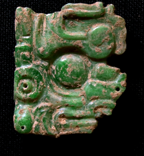 Jade objects unearthed at the Copan site in Honduras. (Photo/CHINA DAILY)