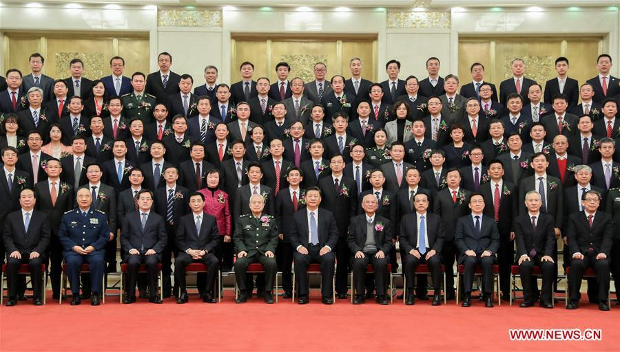 Chinese President Xi Jinping, also general secretary of the Communist Party of China (CPC) Central Committee and chairman of the Central Military Commission, and other leaders, including Li Keqiang, Wang Huning, and Han Zheng, all members of the Standing Committee of the Political Bureau of the CPC Central Committee, pose for a group photo with representatives of the winners before an annual ceremony to honor distinguished scientists, engineers, and research achievements at the Great Hall of the People in Beijing, capital of China, Jan. 8, 2019. (Xinhua/Xie Huanchi)