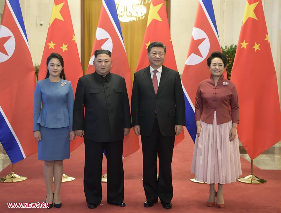 Xi Jinping (2nd R), general secretary of the Central Committee of the Communist Party of China and Chinese president, and his wife Peng Liyuan (1st R) pose for photos with Kim Jong Un (2nd L), chairman of the Workers\' Party of Korea and chairman of the State Affairs Commission of the Democratic People\'s Republic of Korea, and his wife Ri Sol Ju in Beijing, capital of China, Jan. 8, 2019. Xi Jinping on Tuesday held talks with Kim Jong Un, who arrived in Beijing on the same day for a visit to China. Before the talks, Xi Jinping held a welcoming ceremony for Kim Jong Un at the Great Hall of the People in Beijing. (Xinhua/Li Xueren)
