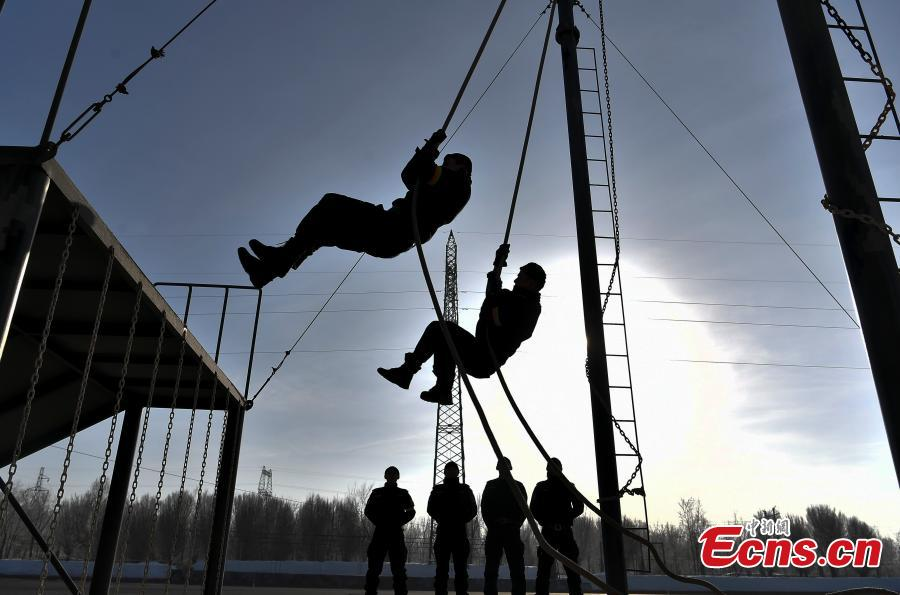 Members of the special police force of Urumqi City, Northwest China\'s Xinjiang Uygur Autonomous Region, undergo an intensive training at a snow field in freezing conditions, Jan. 9, 2019. The 60-plus day winter training included running, the use of police equipment and combat skills. (Photo: China News Service/Liu Xin)