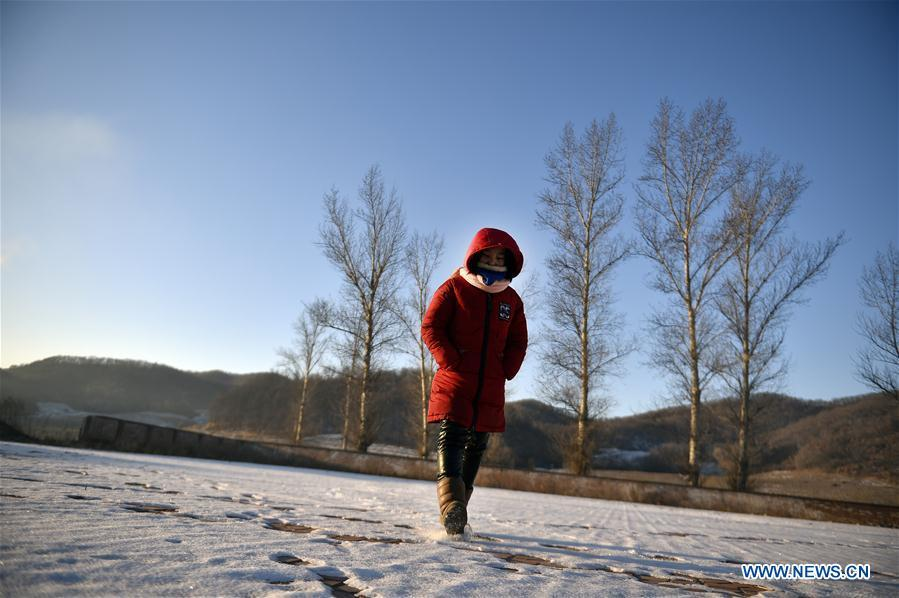 Sun Xiaofeng walks on the snow on the playground before classes at Yantai primary school in Yantai Village of Lianhua Township in Tieling City, northeast China\'s Liaoning Province, Jan. 8, 2019. Located in a remote mountain village, most students of Yantai school had transferred to other places outside the mountain. Sun Xiaofeng, a third grade student, became the only student of the school in September last year taught by Hu Zhisheng, the only one faculty of Yantai primary school. (Xinhua/Yao Jianfeng)