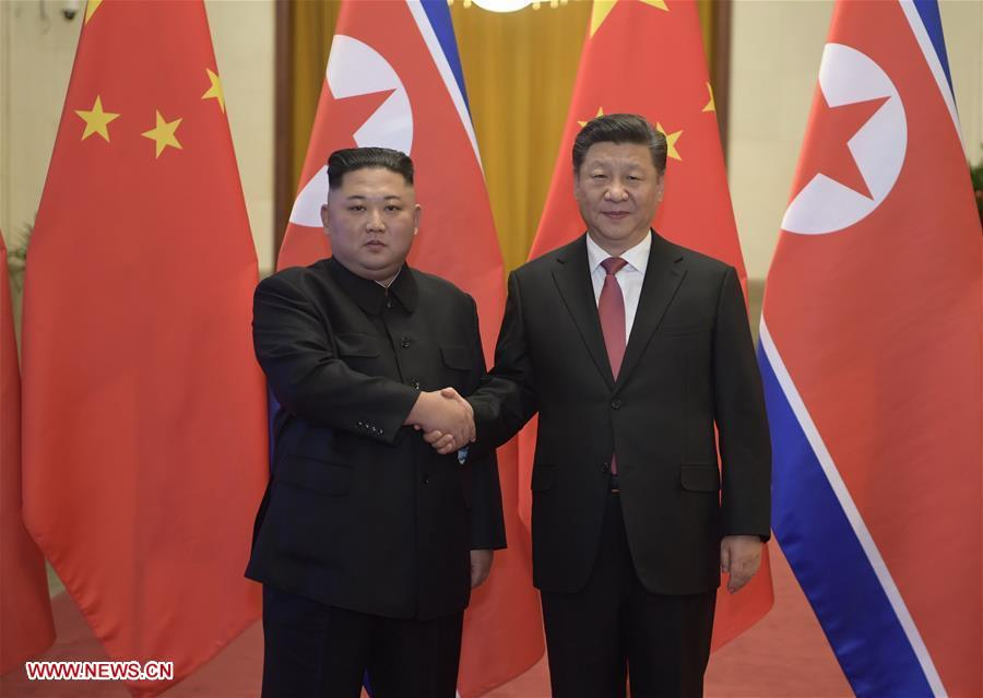 Xi Jinping (R), general secretary of the Central Committee of the Communist Party of China and Chinese president, holds a welcoming ceremony for Kim Jong Un, chairman of the Workers\' Party of Korea and chairman of the State Affairs Commission of the Democratic People\'s Republic of Korea, before their talks at the Great Hall of the People in Beijing, capital of China, Jan. 8, 2019. Xi Jinping on Tuesday held talks with Kim Jong Un, who arrived in Beijing on the same day for a visit to China. (Xinhua/Li Xueren)