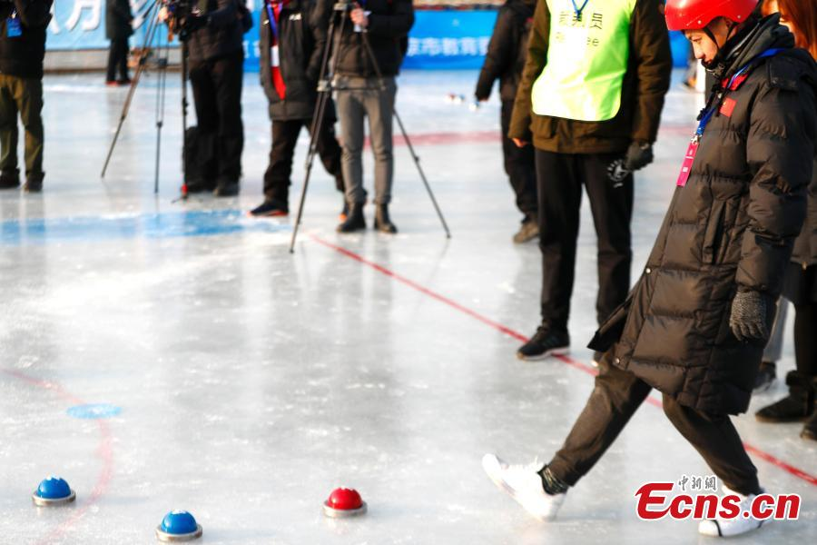 Players compete in cuju, an ancient Chinese football game, during the first Beijing Winter Games held at Houhai Ice Arena in Beijing, Jan. 10, 2019. More than 180 participants on 16 teams representing all districts in the capital city joined the competition. Playing cuju on ice has long been a traditional folk sport in Beijing. (Photo: China News Service/Fu Tian)