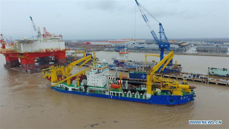 Chinese-built dredging vessel Tian Kun Hao is moored at the shipyard after completing its sea trial on Jan. 9, 2019. Tian Kun Hao, a Chinese-built dredging vessel, which is the largest of its kind in Asia, returned to the shipyard Wednesday after completing its sea trial of nearly three months. The 140-meter-long, 27.8-meter-wide vessel can dig as deep as 35 meters under the sea floor and dredge 6,000 cubic meters per hour, according to its investor, Tianjin Dredging Co., a subsidiary of China Communication Construction Co. (Xinhua)