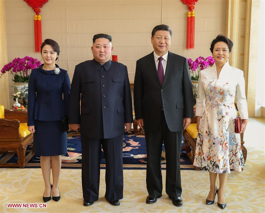 Xi Jinping (2nd R), general secretary of the Central Committee of the Communist Party of China and Chinese president, and his wife Peng Liyuan (1st R) pose for photos with Kim Jong Un (2nd L), chairman of the Workers\' Party of Korea and chairman of the State Affairs Commission of the Democratic People\'s Republic of Korea, and his wife Ri Sol Ju at Beijing Hotel in Beijing, capital of China, Jan. 9, 2019. Xi Jinping on Tuesday held talks with Kim Jong Un, who arrived in Beijing on the same day for a visit to China. On Wednesday, Xi Jinping met with Kim Jong Un at Beijing Hotel. (Xinhua/Huang Jingwen)