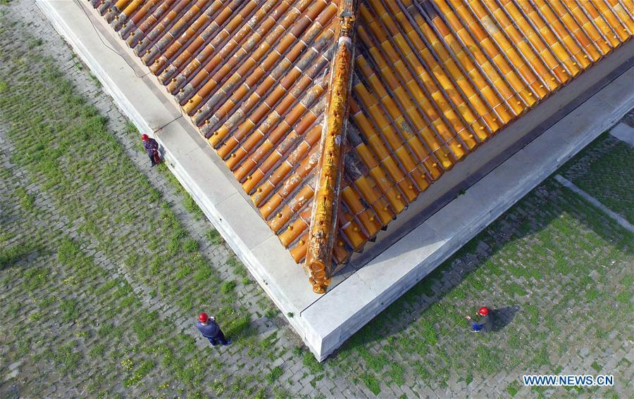 Technical staff check lightning protection facilities at the eastern royal tombs of the Qing Dynasty (1644-1911), a historic building complex, in Zunhua City of Tangshan, north China\'s Hebei Province, May 8, 2018. The National Cultural Heritage Administration will work out a plan to better protect cultural relics and speed up the creation of a safety oversight platform in 2019. Stressing the importance of such protection, Liu Yuzhu, head of the administration, said lax enforcement is a prominent problem that endangers cultural relics, at a meeting attended by cultural heritage administrators nationwide. (Xinhua/Liu Mancang)