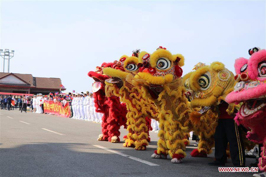 People perform lion dance to welcome the 30th fleet of Chinese navy escort at Sihanoukville Autonomous Port, Cambodia, Jan. 9, 2019. The 30th Chinese naval escorting fleet, composed of missile frigates \