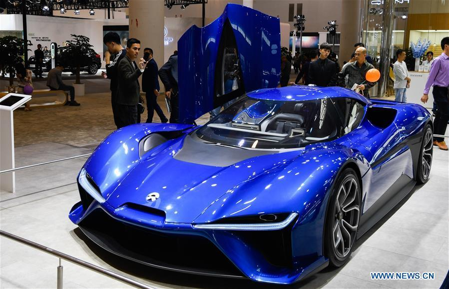 Visitors view a car from Chinese electric automaker Nio at Haikou New Energy Vehicle Exhibition in Haikou, south China\'s Hainan Province, Jan. 10, 2019. A total of 197 new energy vehicles were displayed at the exhibition. (Xinhua/Yang Guanyu)