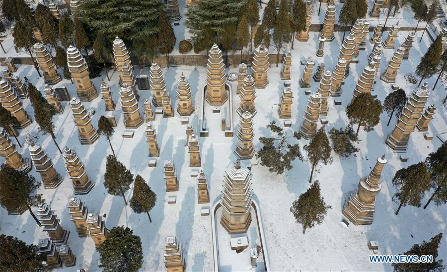Aerial photo taken on Jan. 10, 2019 shows the snow-covered Pagoda Forest of Shaolin Temple in Dengfeng City, central China\'s Henan Province. (Xinhua/Feng Dapeng)