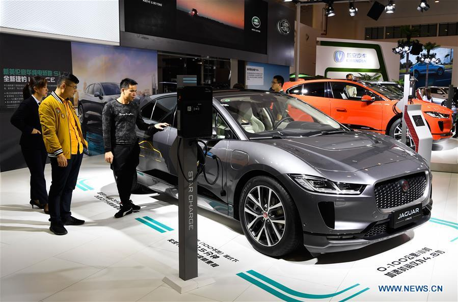 Visitors view a new energy car of Jaguar at Haikou New Energy Vehicle Exhibition in Haikou, south China\'s Hainan Province, Jan. 10, 2019. A total of 197 new energy vehicles were displayed at the exhibition. (Xinhua/Yang Guanyu)