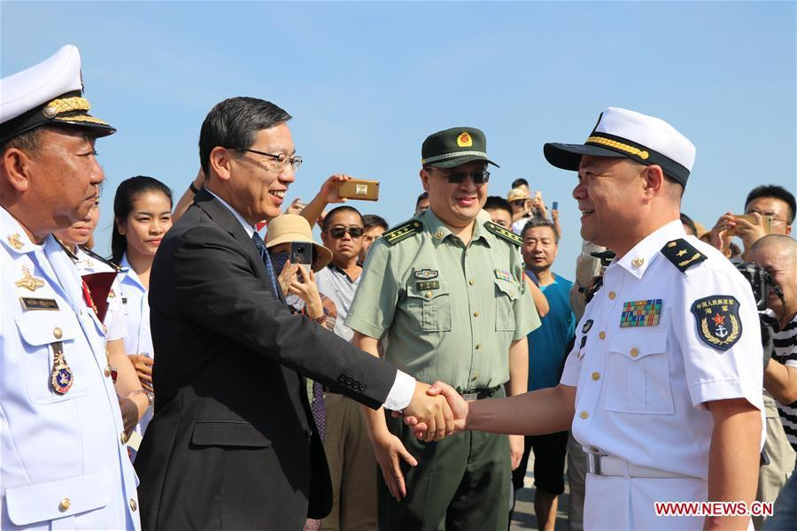 Rear Admiral Xu Haihua (R), commander of the 30th fleet of Chinese navy escort, shakes hands with Chinese Ambassador to Cambodia Wang Wentian during a welcoming ceremony at Sihanoukville Autonomous Port, Cambodia, Jan. 9, 2019. The 30th Chinese naval escorting fleet, composed of missile frigates \