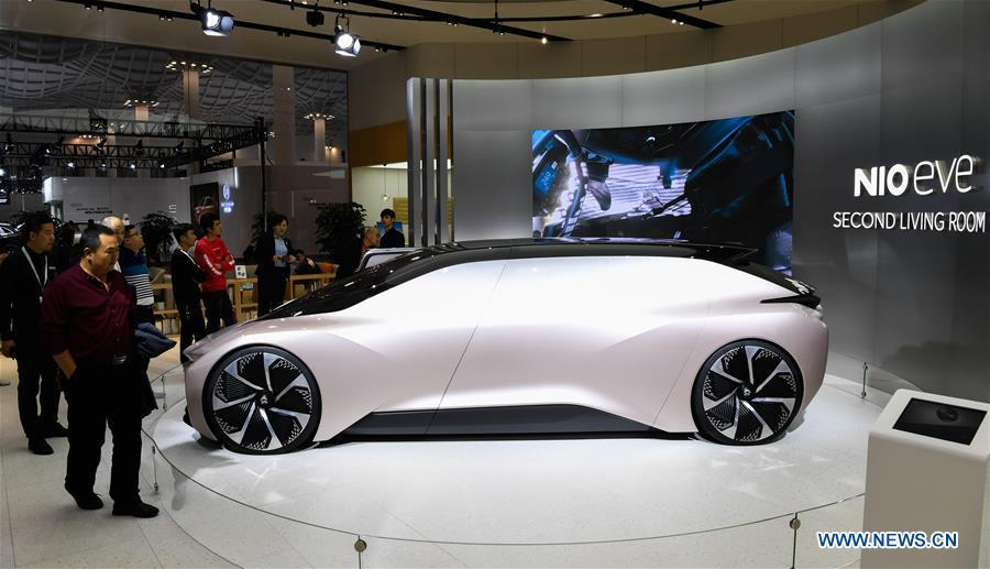 Visitors view the concept car EVE from Chinese electric automaker Nio at Haikou New Energy Vehicle Exhibition in Haikou, south China\'s Hainan Province, Jan. 10, 2019. A total of 197 new energy vehicles were displayed at the exhibition. (Xinhua/Yang Guanyu)