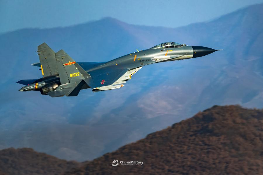 A J-11B fighter jet attached to an aviation brigade of the air force with the PLA Northern Theater Command flies at low altitude through valleys during a flight training exercise on January 8, 2019.  (Photo/eng.chinamil.com.cn)