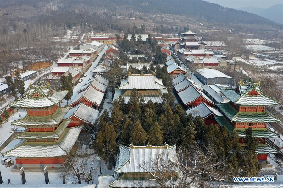 Aerial photo taken on Jan. 10, 2019 shows the snow-covered Shaolin Temple in Dengfeng City, central China\'s Henan Province. (Xinhua/Feng Dapeng)