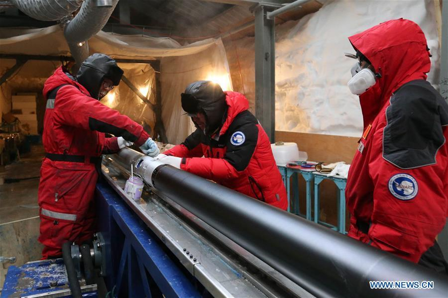 Members of one of two inland expedition teams on China\'s 35th Antarctic expedition maintain the drilling equipment at the Kunlun Station in Antarctica, Jan. 12, 2019. (Xinhua/Liu Shiping)