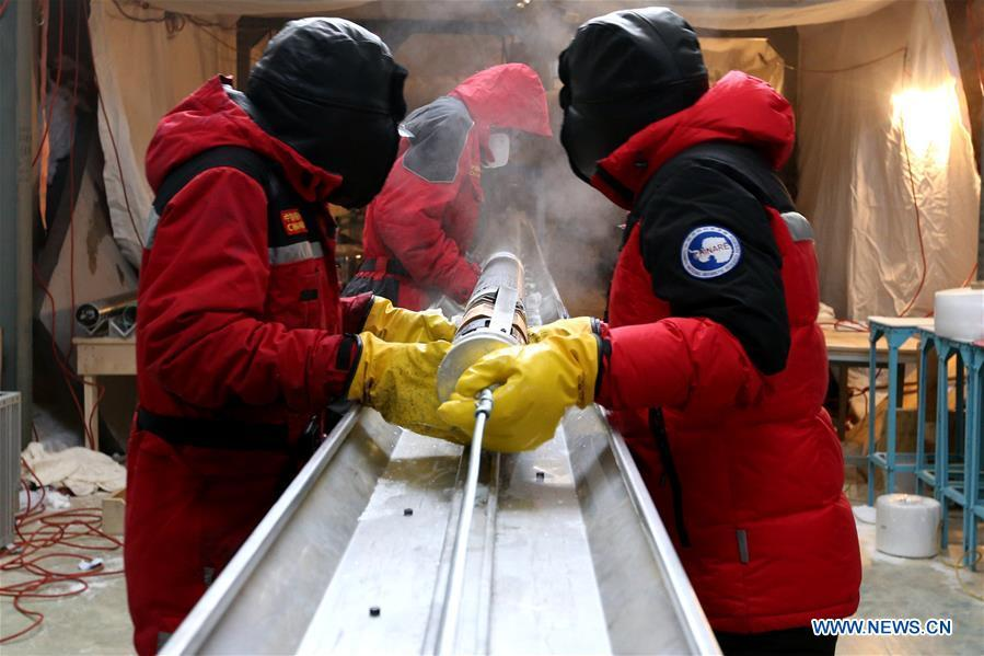 Members of one of two inland expedition teams on China\'s 35th Antarctic expedition handle the newly-drilled ice core at the Kunlun Station in Antarctica, Jan. 12, 2019. (Xinhua/Liu Shiping)