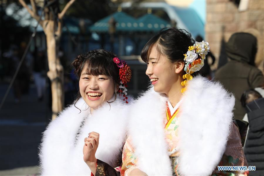 Japanese girls in kimonos celebrate Coming of Age together at Tokyo Disneyland in Chiba, Japan, Jan. 14, 2019. People who turned 20-year-old took part in the annual Coming of Age Day ceremony in Japan on Monday. (Xinhua/Du Xiaoyi)