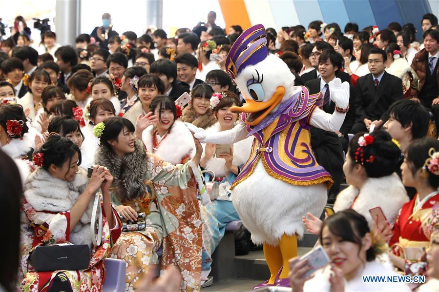 Japanese boys and girls celebrate Coming of Age with a Disney character at Tokyo Disneyland in Chiba, Japan, Jan. 14, 2019. People who turned 20-year-old took part in the annual Coming of Age Day ceremony in Japan on Monday. (Xinhua/Du Xiaoyi)
