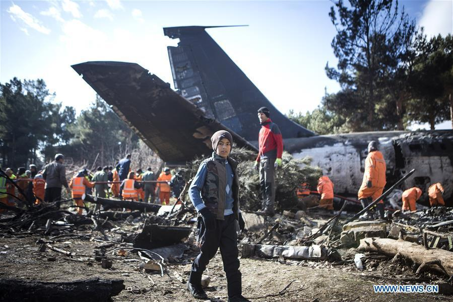 A boy walks on the site of a Boeing 707 plane crash in Karaj, Iran, Jan. 14, 2019. At least 15 people were killed on Monday in the crash. (Xinhua/Ahmad Halabisaz)