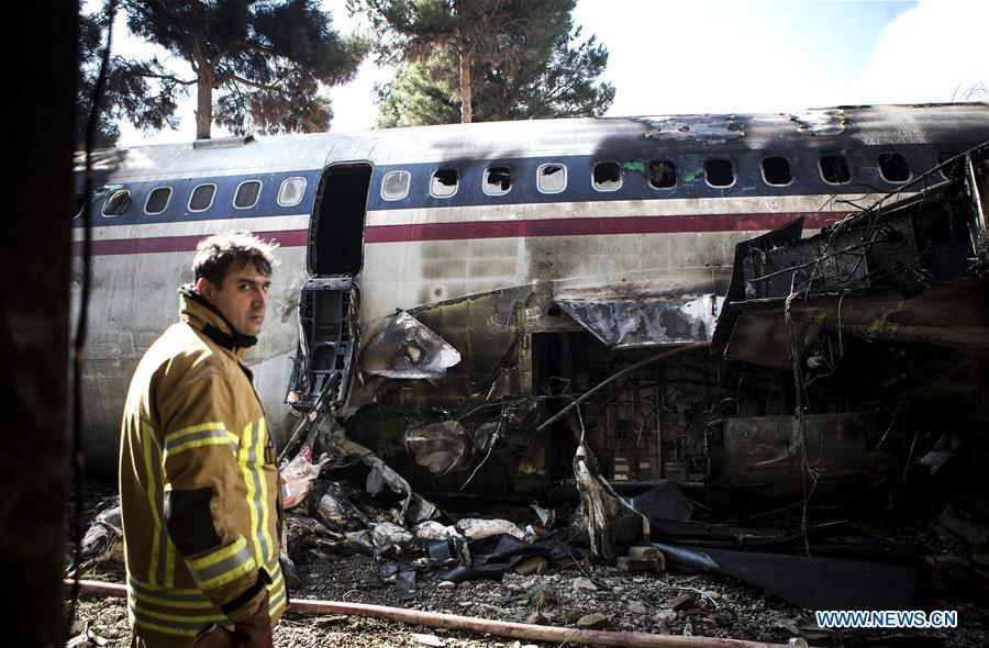 A rescuer stands at the crash site of a Boeing 707 plane in Karaj, Iran, Jan. 14, 2019. At least 15 people were killed on Monday in the crash. (Xinhua/Ahmad Halabisaz)