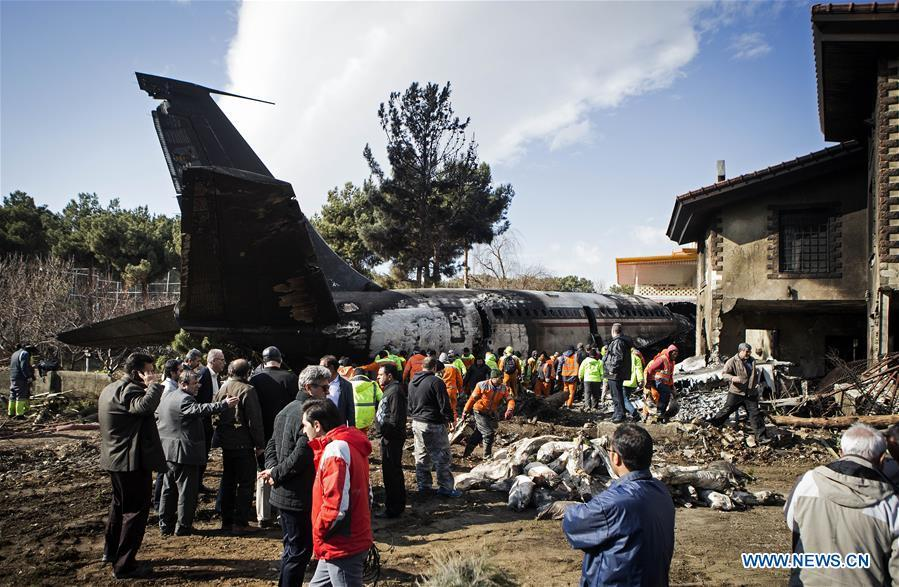 Rescuers work at the crash site of a Boeing 707 plane in Karaj, Iran, Jan. 14, 2019. At least 15 people were killed on Monday in the crash. (Xinhua/Ahmad Halabisaz)