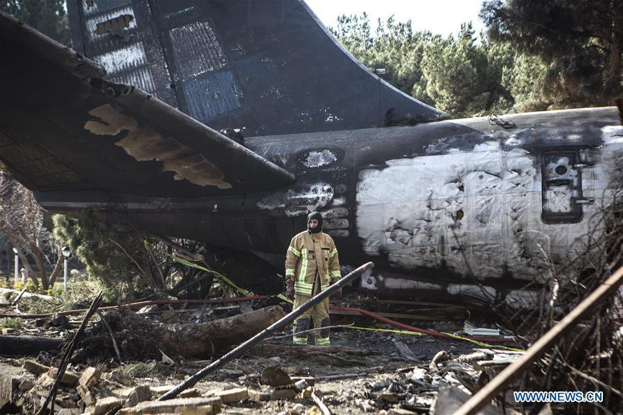 A rescuer works at the crash site of a Boeing 707 plane in Karaj, Iran, Jan. 14, 2019. At least 15 people were killed on Monday in the crash. (Xinhua/Ahmad Halabisaz)