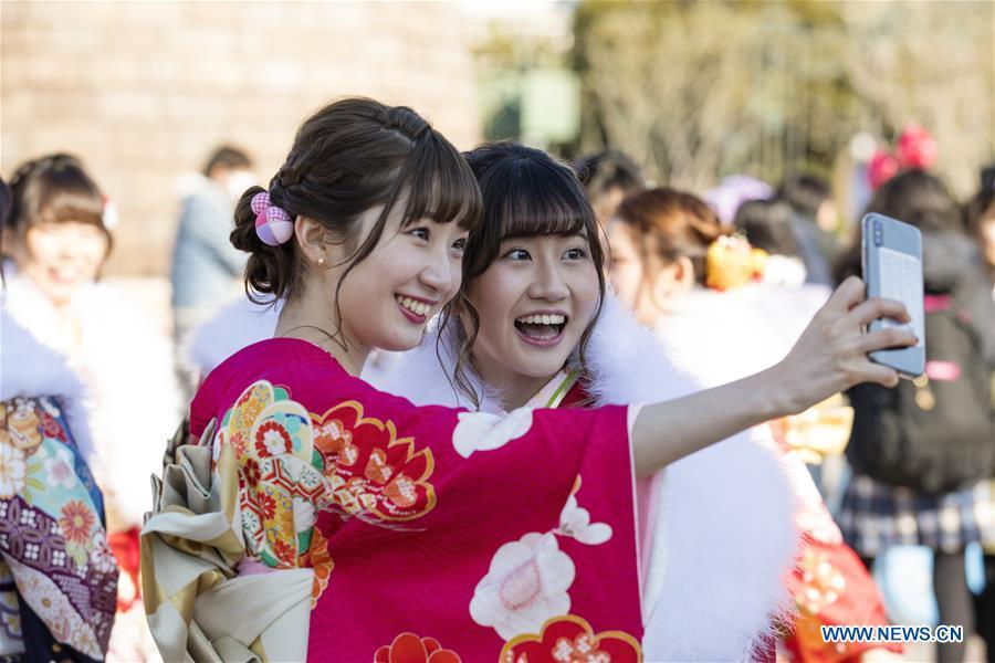 Japanese girls in kimonos take selfies to celebrate Coming of Age together at Tokyo Disneyland in Chiba, Japan, Jan. 14, 2019. People who turned 20-year-old took part in the annual Coming of Age Day ceremony in Japan on Monday. (Xinhua/Du Xiaoyi)