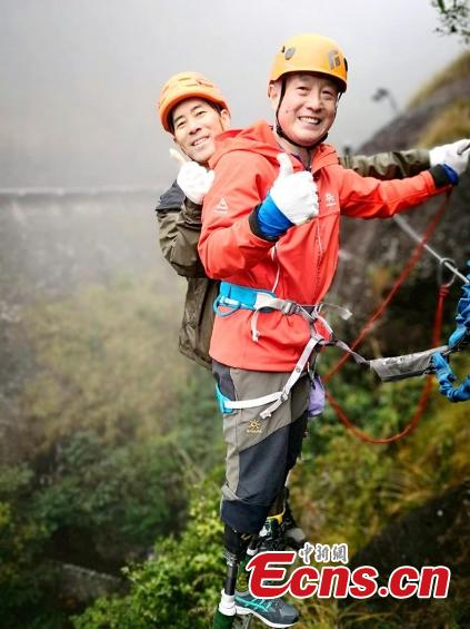 Double amputee Xia Boyu attempts a via ferrata climbing route at Shenxianju, a geological site known for its cliffs and waterfalls, in Taizhou City, East China\'s Zhejiang Province, Jan. 14, 2019. A via ferrata is a protected climbing route. Xia became a double amputee after suffering severe frostbite in both feet while attempting to climb Mount Qomolangma in 1975. The 70 year old scaled the world\'s highest peak as the first double amputee climber from the Nepali side on May 14, 2018. (Photo: China News Service/Ying Jianfei)