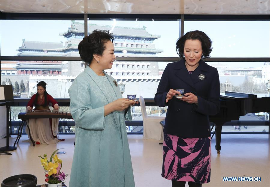 Peng Liyuan (L, front), the wife of Chinese President Xi Jinping, attends a show including poetry reading and musical performances with Jenni Haukio, wife of Finnish President Sauli Niinisto, in Beijing, capital of China, Jan. 15, 2019. (Xinhua/Ding Lin)
