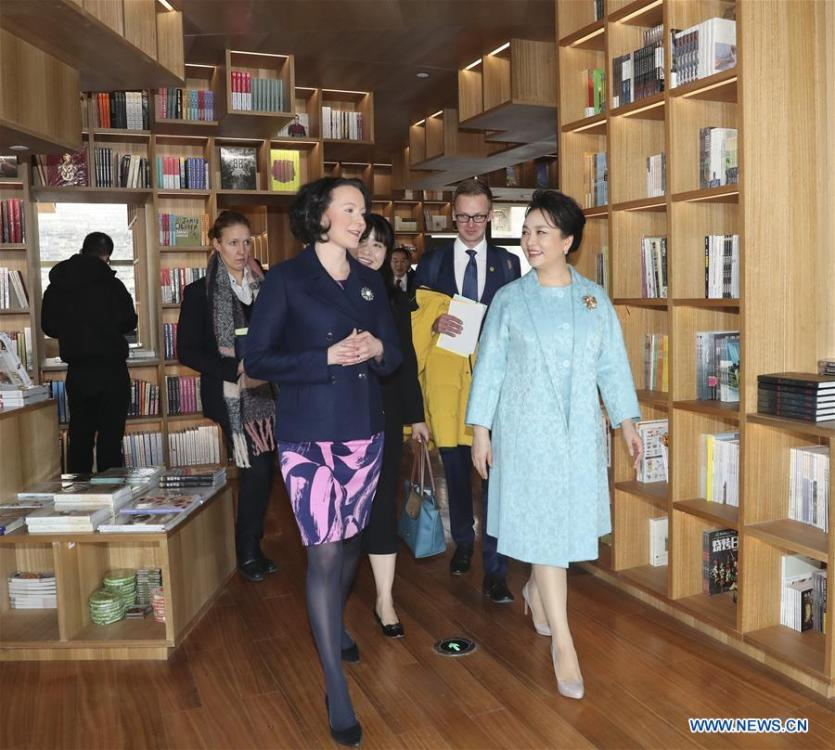 Peng Liyuan (R, front), the wife of Chinese President Xi Jinping, attends a show including poetry reading and musical performances with Jenni Haukio, wife of Finnish President Sauli Niinisto, in Beijing, capital of China, Jan. 15, 2019. (Xinhua/Ding Lin)